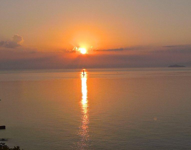 sun-rise in first morning: sea sail sun silence