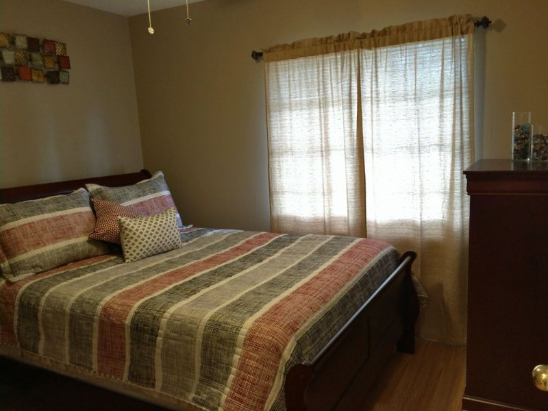 Guest bedroom 1 Queen Bed, Night Stand, Table Lamp, Chest drawer, Ceiling Fan