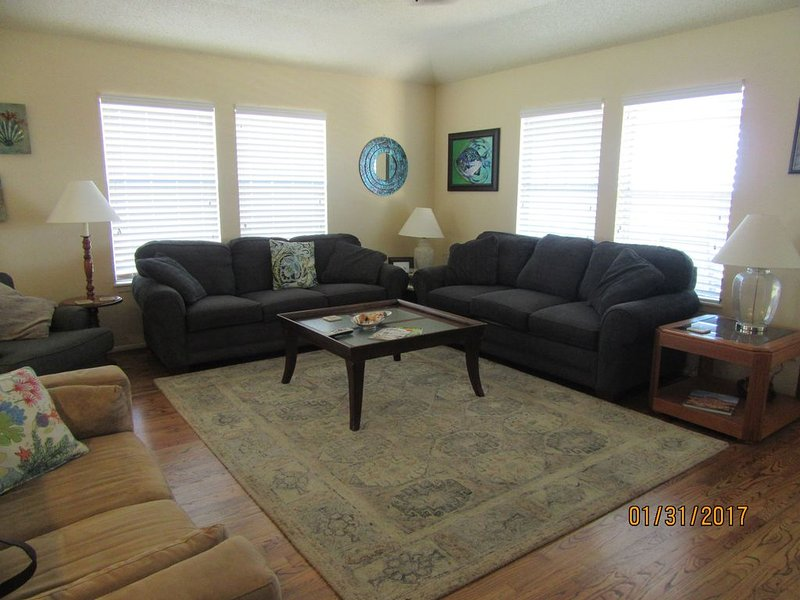 Lots of Seating for Everyone, 2 sofas, 1 love seat, and a recliner