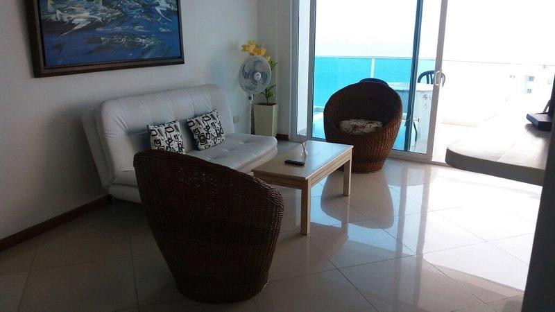 living room with tv plasma