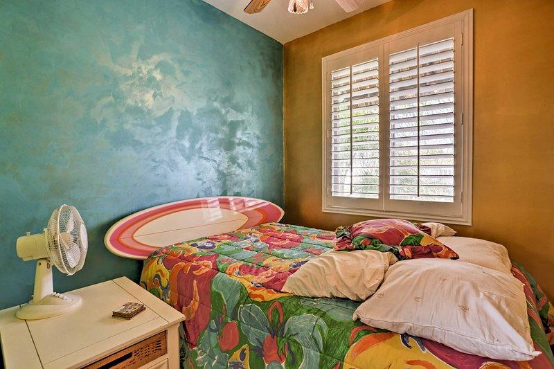 The main floor bonus room offers a full bed.