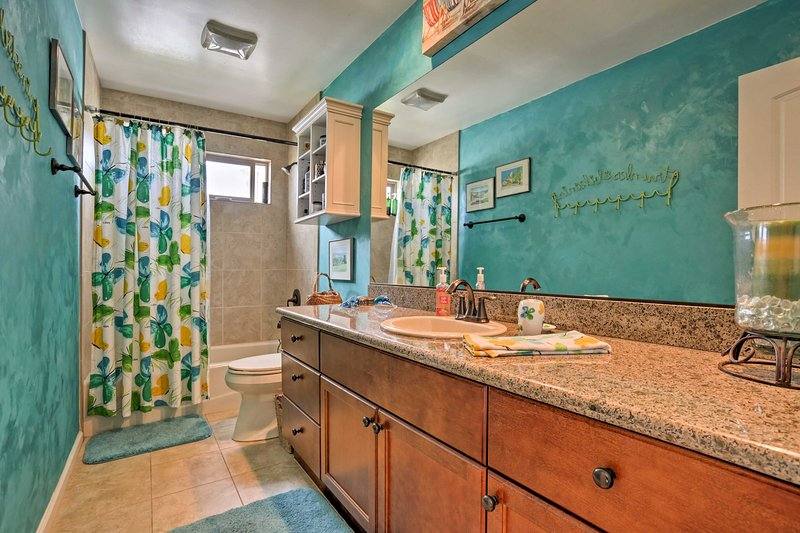Get ready for the day in this spacious en-suite bathroom.