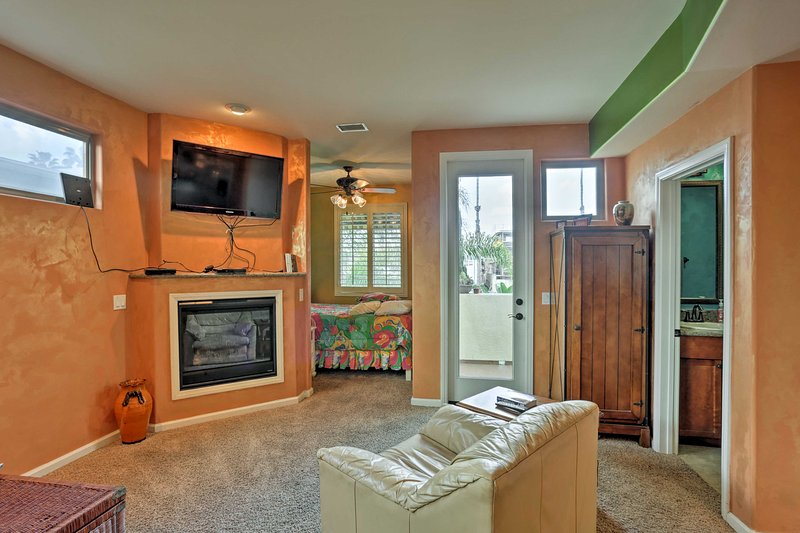 Curl up on the armchair in front of the gas fireplace and flat-screen Smart TV in the living area.