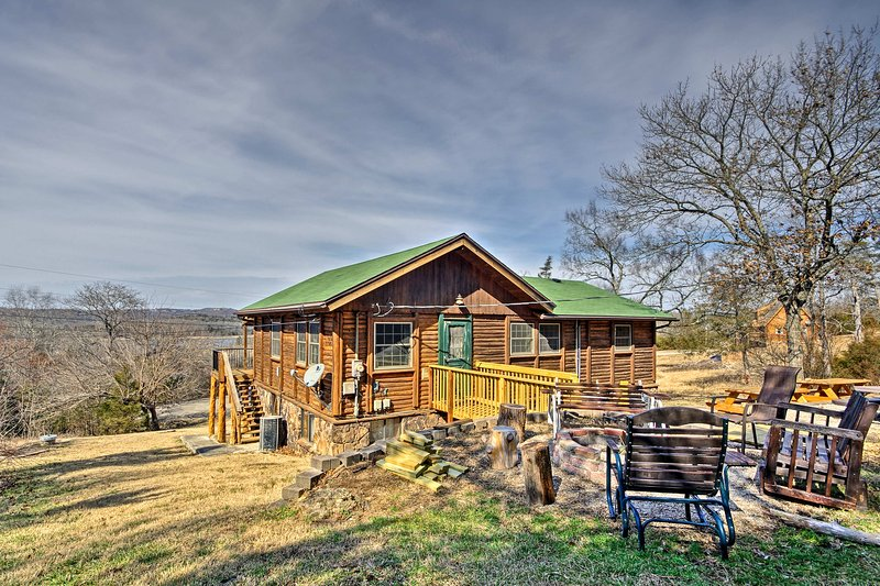 This cabin sleeps 16 guests and sits just a short walk from Table Rock Lake.