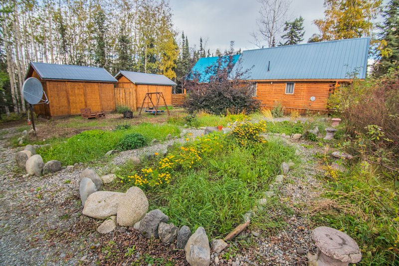 Discover inner peace at the zen garden and explore the surrounding acreage while staying at the riverside property.