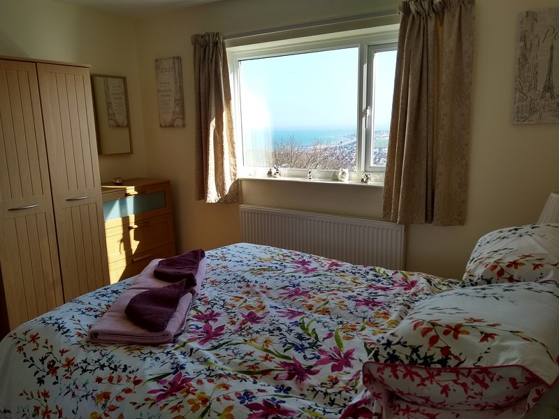 Front king size bedroom with views over the bay..
