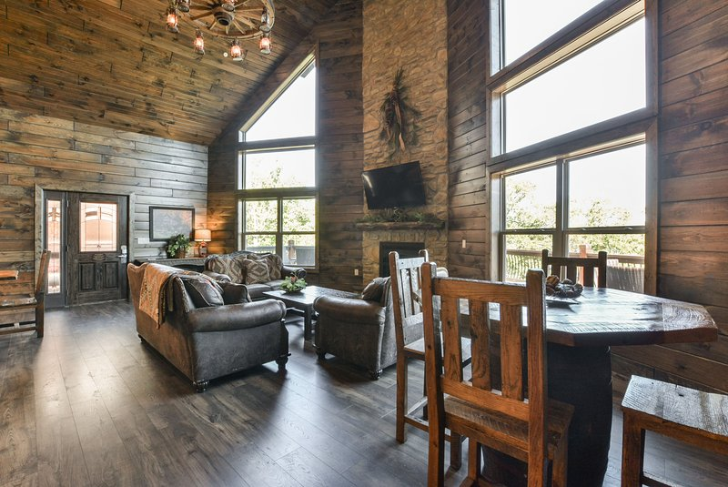 Spacious and comfortable living room with open floor plan to kitchen & dining