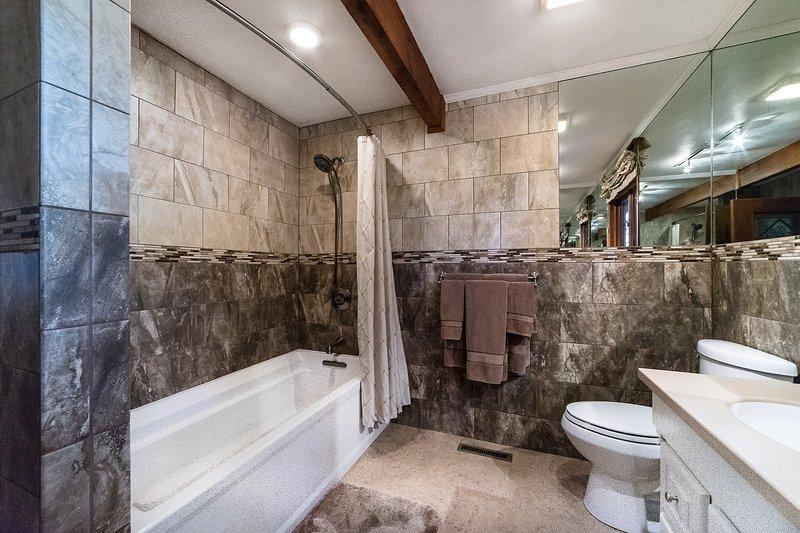 Extra long tub in ground floor bath room