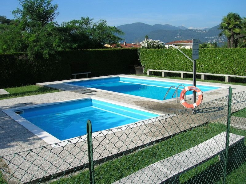 Nicole 1 apartment located in a residential complex with swimming pool, holiday rental in Germignaga