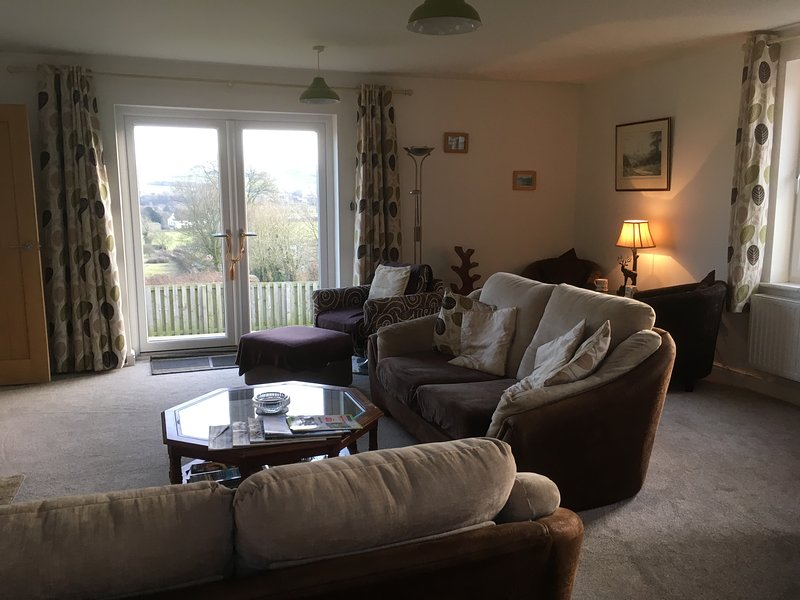 Lounge with with view of fells and log burner and reading area