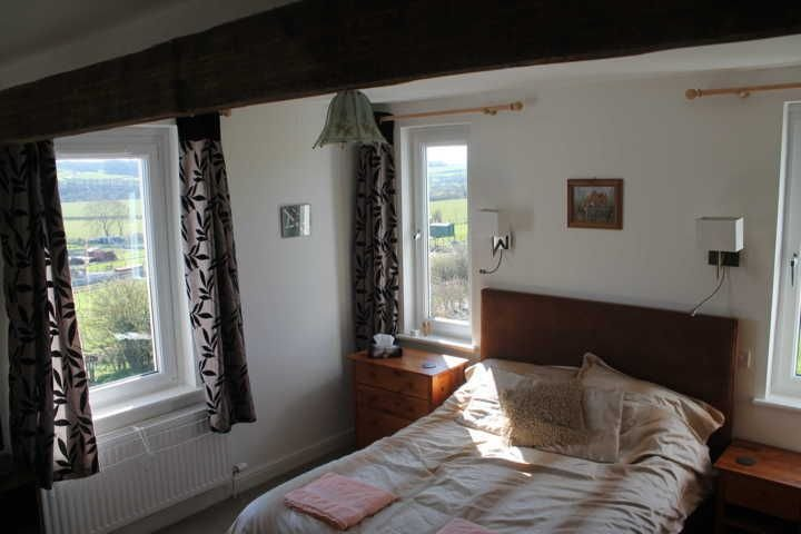 Main bedroom with ensuite shower room and views of fells and countryside