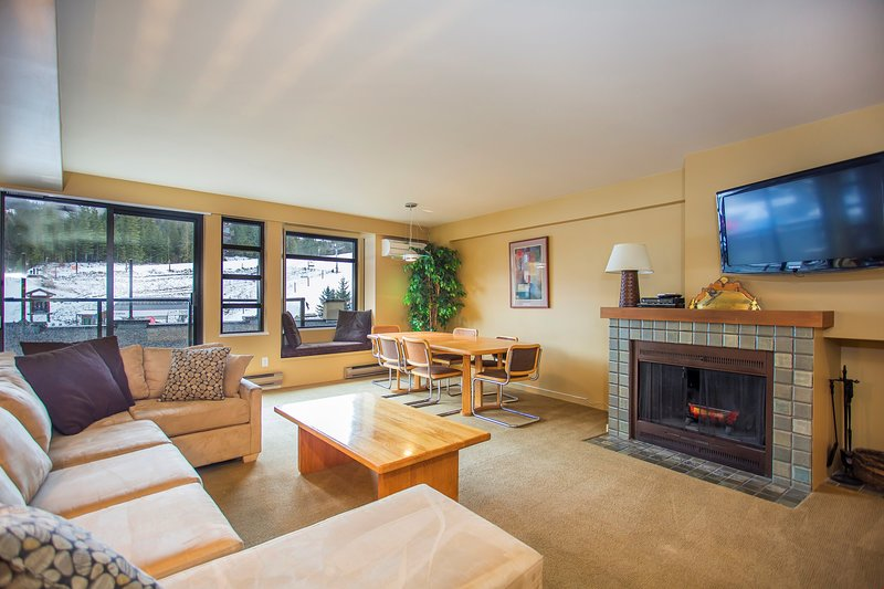 The living area has views of Whistler mountain and is spacious and perfect for entertaining