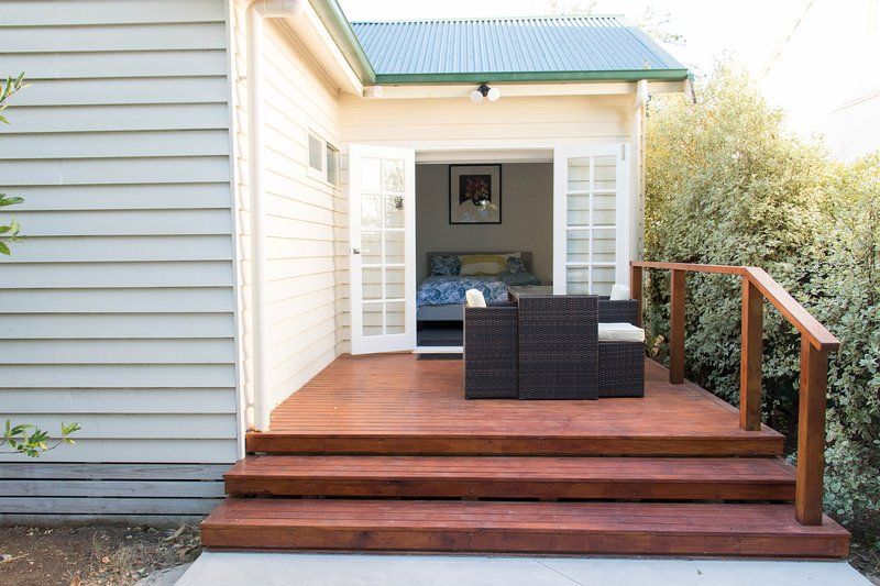 Enter our apartment through French doors from the spacious timber decking.