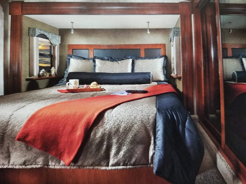 """Full height kingsize separate bedroom with 32"""" tv, fan, heating and air conditioning."""