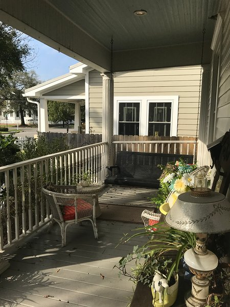 Front porch swing, great place to enjoy the gulf breeze!