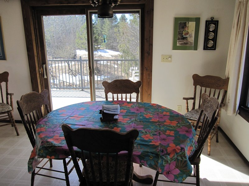 spacious kitchen has plenty of room for more than 1 cook; sliding doors to deck overlooking yard.