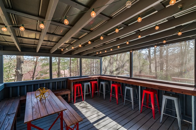 Relax on the screened in porch or pull up a stool to the bar!