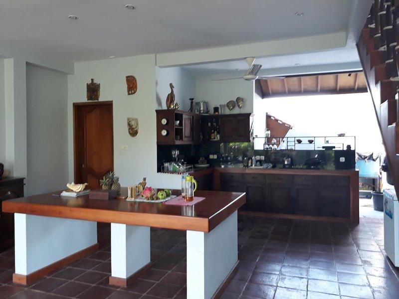 open air kitchen with mahogany island
