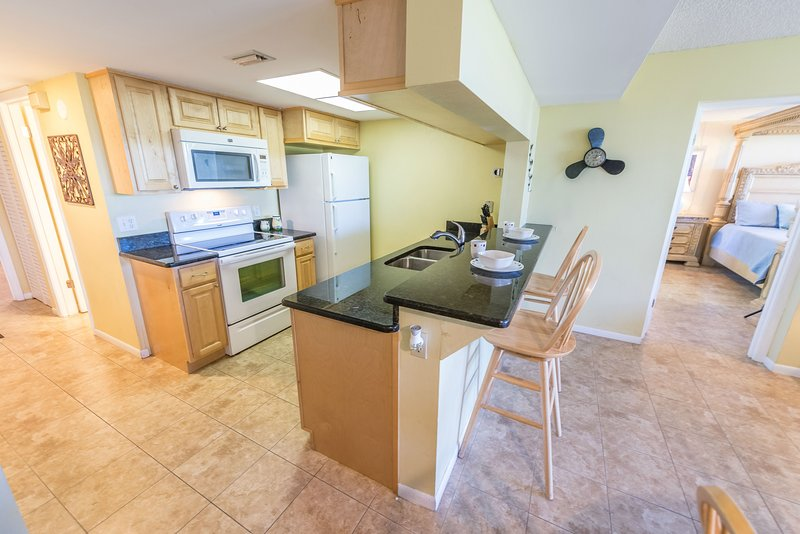 Renovated open concept kitchen with granite counters