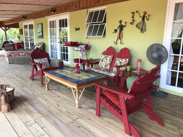 Veranda that is the outdoor living space designated for the Sweet Bungalow