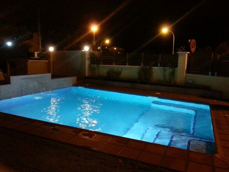 Illuminated pool. Beautiful and romantic nights by the pool