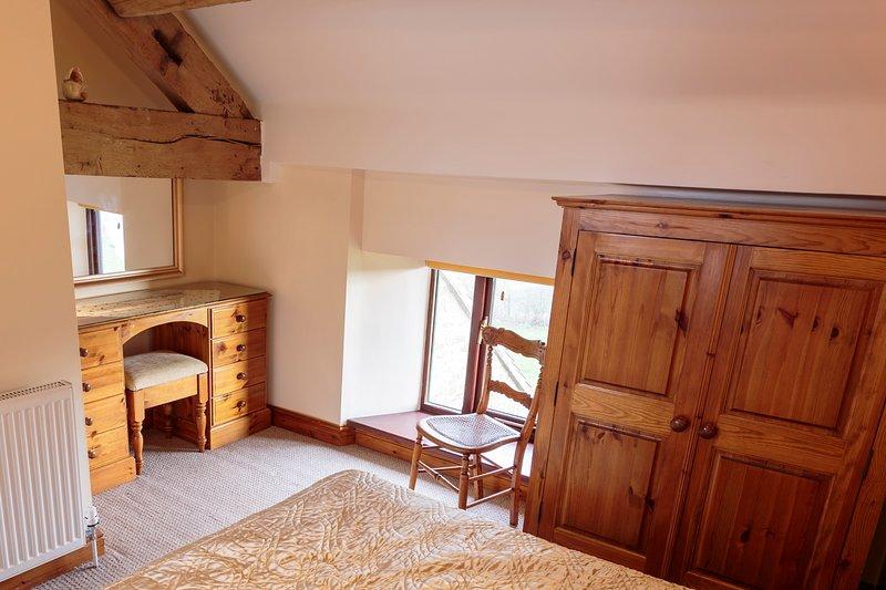 Dressing table in Double Bedroom showing interesting oak beams