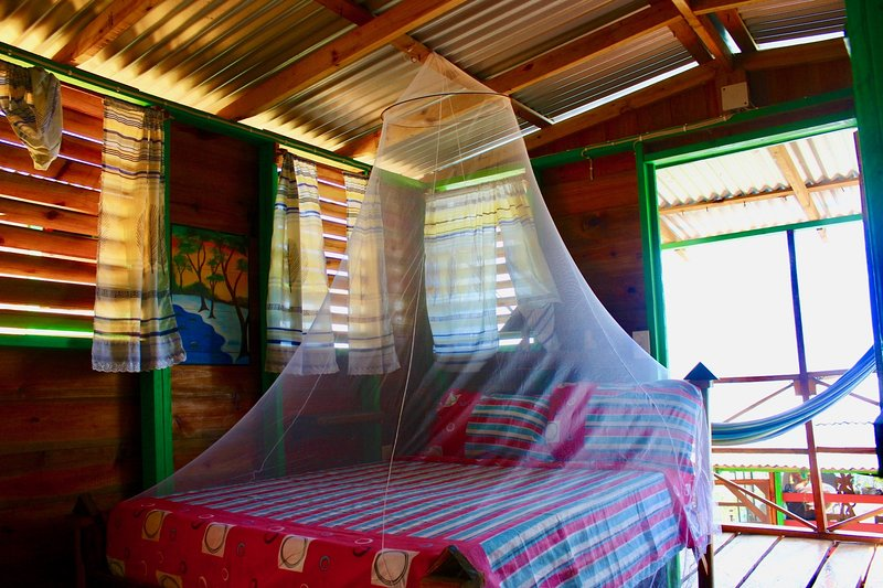 Bedroom with double bed & net.