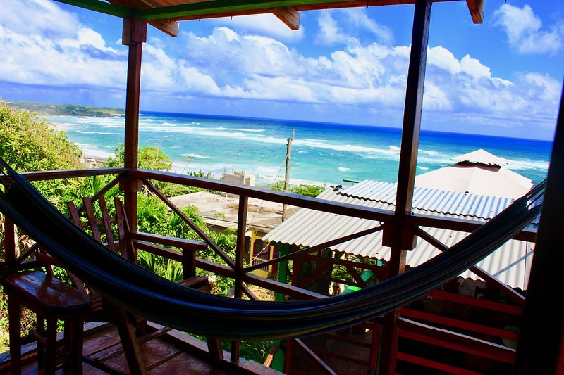 Cabin balcony with hammocks & sea view.