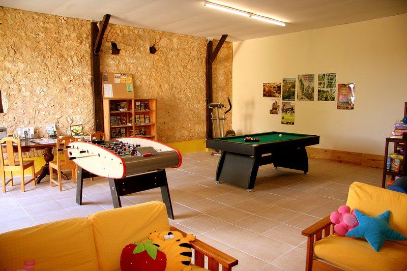 spacious games room with toys, books, snooker, table football and tourist information