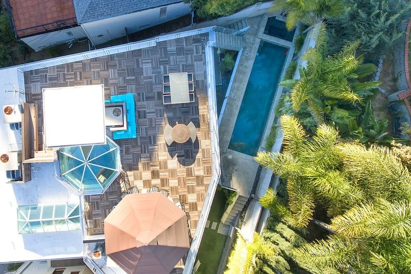Spend your holidays in modern luxury at this hilltop villa with roof top deck, pool and spa