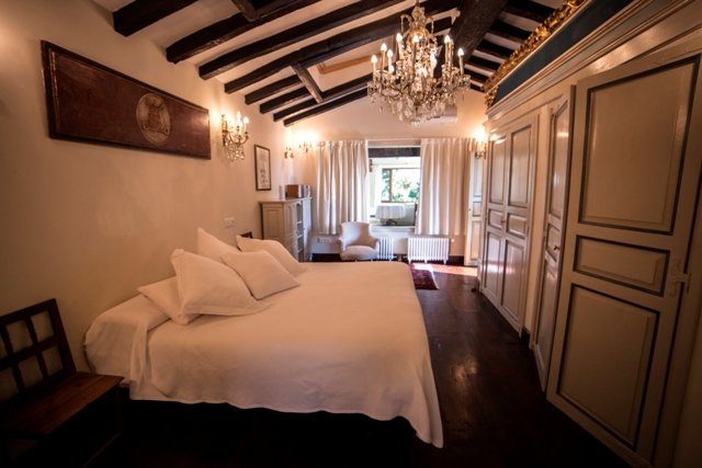 Bedroom with antique wooden floors, spacious closets and exquisite decor.