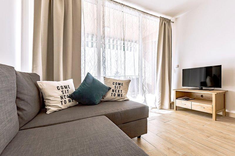 sala de estar con sofá-cama