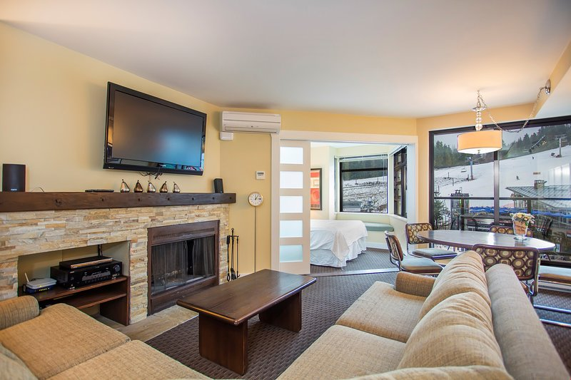 Kick back your feet and relax next to the wood burning fireplace and spectacular views of Whistler Village