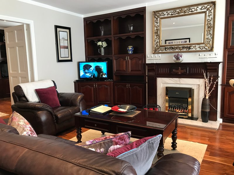 Sitting room leading into a separate living room.