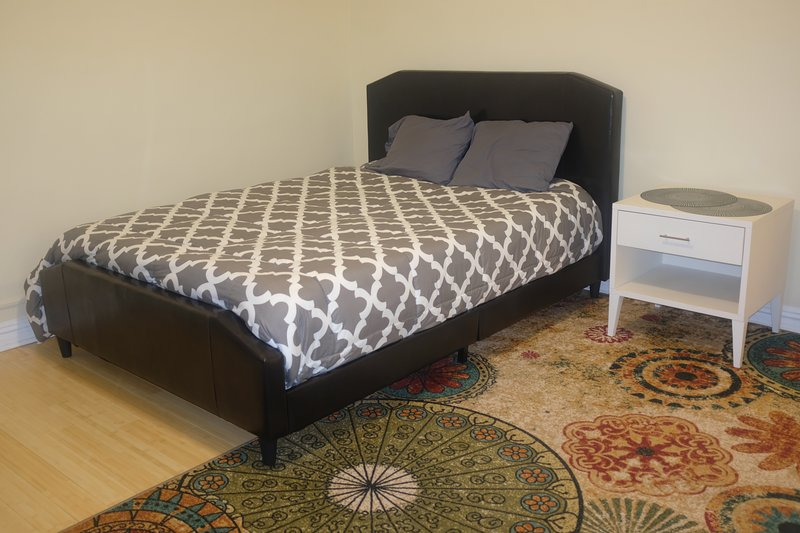 Gigantic bedroom has tons of natural light and a brand new queen size bed with memory foam mattress.