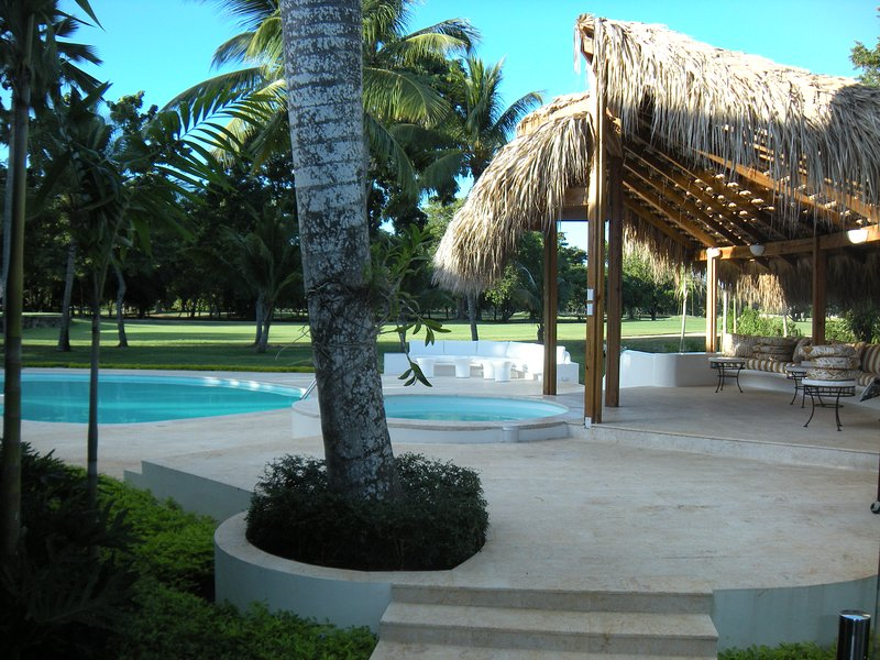 Exit from den to patio, pool, and gazebo