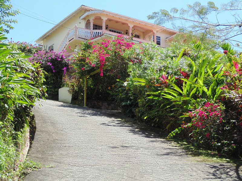 Located on top of hill. This is the  front view of Piton Vista Villa.