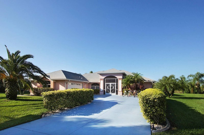 Adorable home on huge corner lot offers privacy and palms add to the Floridian lifestyle