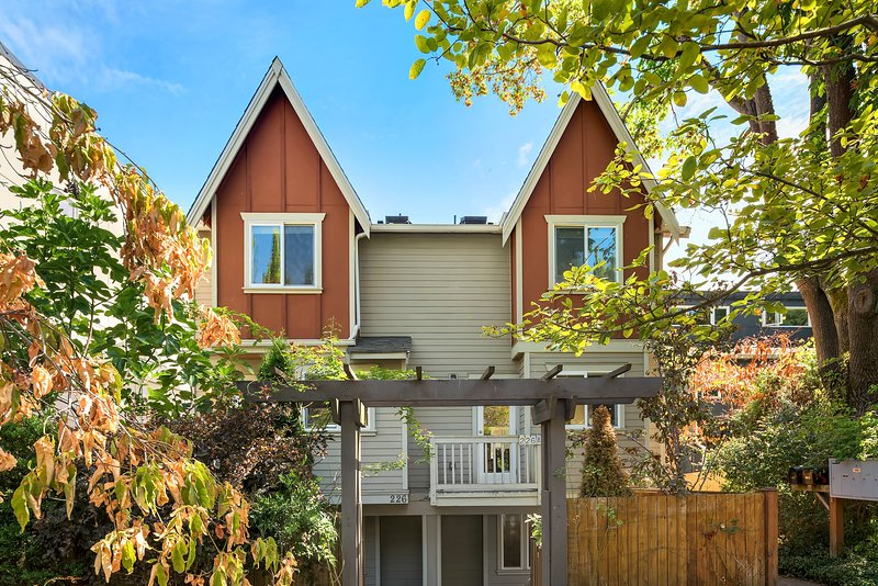 This home is on a quiet, tree-lined street... and the identical adjacent home is also available if your group is larger!