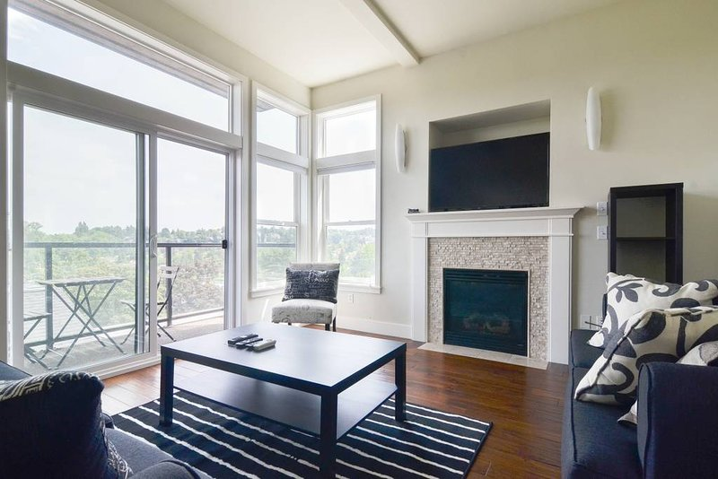 The living room is light and airy, with an outdoor deck for soaking up the views.