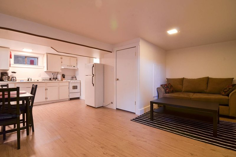 The Dawg Pound has an open living/dining/kitchen area with sleeper sofa and TV