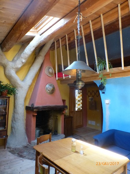 """""""Casetta Azzurra"""", clay tree, living room and loft, entrance door in the background"""