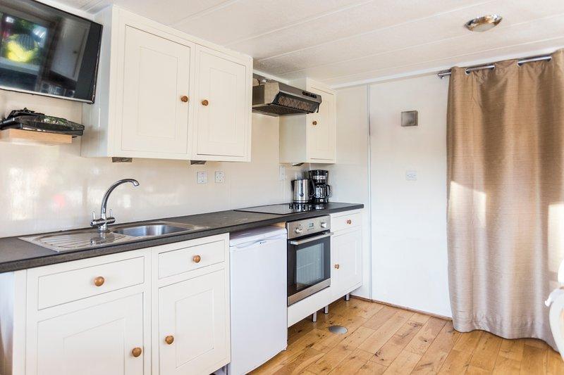 Full kitchen including 4-plate cooker, oven, fridge/freezer, dishwasher, microwave, toaster + kettle