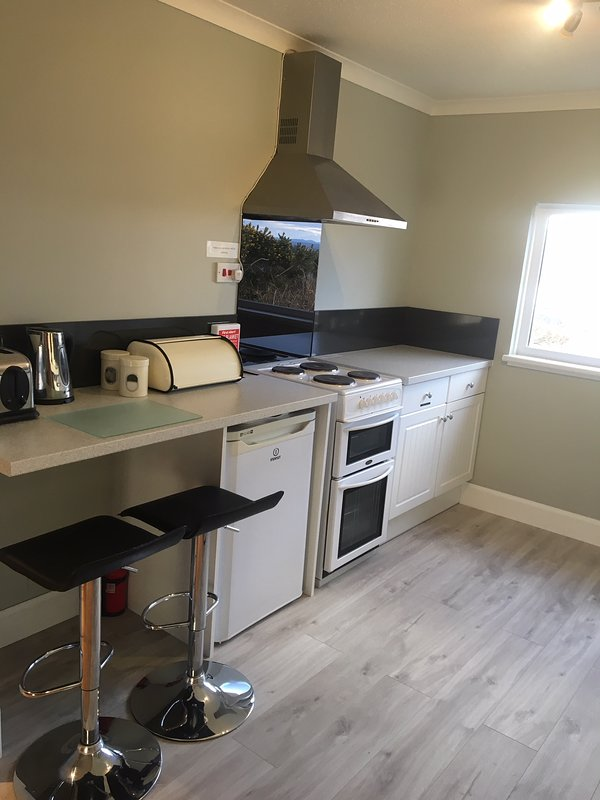 Well equipped, fitted kitchen with cooker, fridge,sink,kettle, toaster, microwave & washing machine