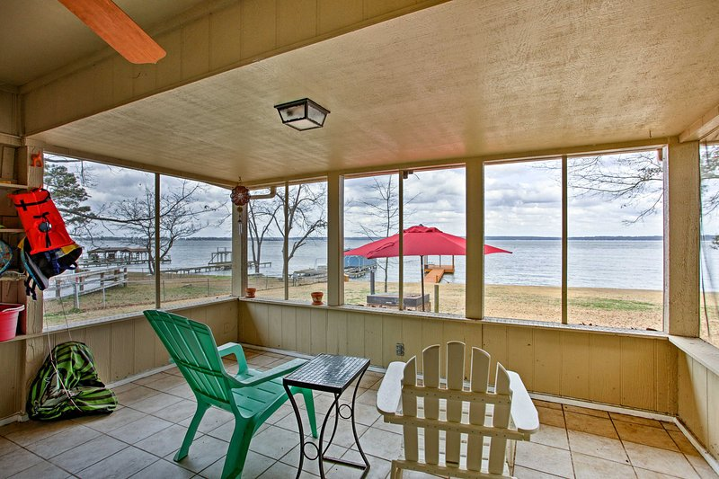 Gaze out at the lake from the screened-in porch.