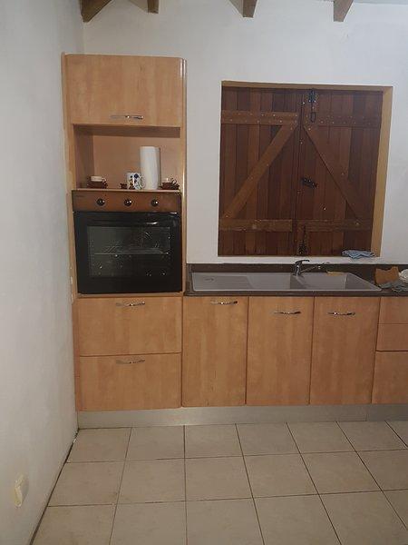 equip kitchen with refrigerator