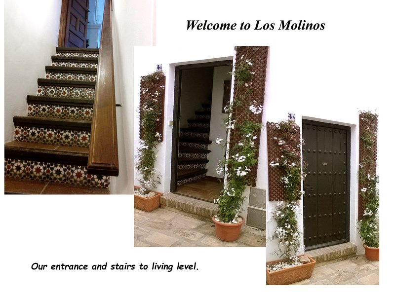 Our traditionally Spanish door and tiled staircase. The plaque says 'Los Molinos'.
