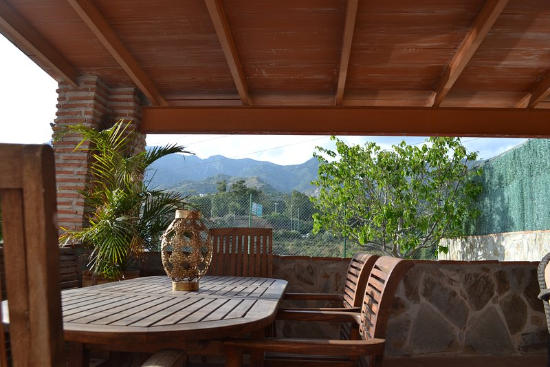 Porch next to the pool with wonderful views of the mountain