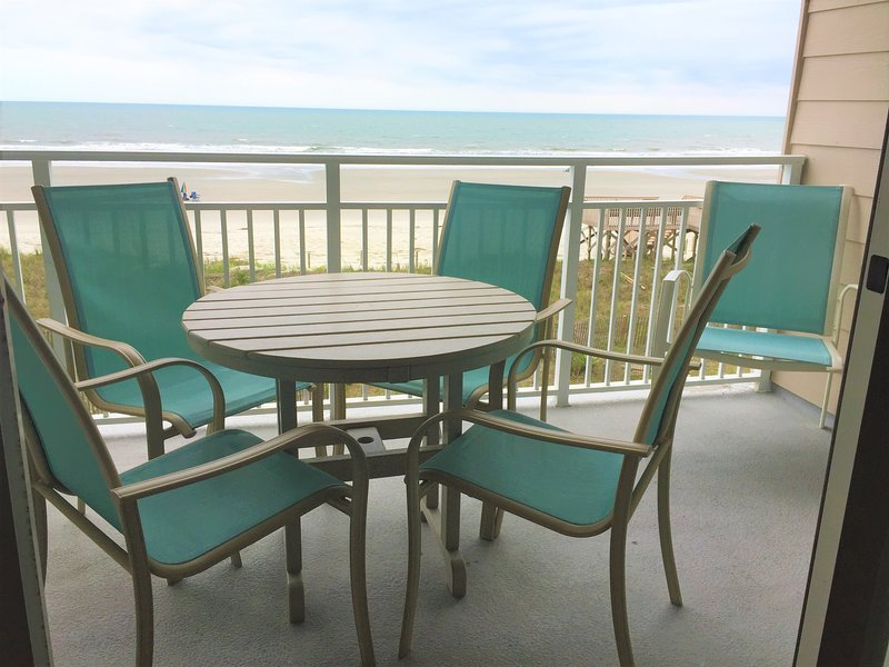 Ocean Front deck off the living room. Coffee-Lunch-Dinner-games on the deck. Watch for dolphins.