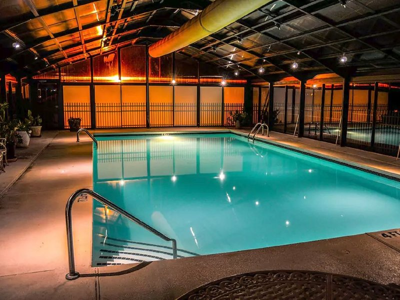 HEATED INDOOR POOL calling your name! Next door to pools, tennis courts, fitness ctr, rest.and more